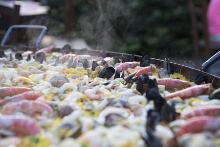 outdoor closeup of cooking  steaming paella