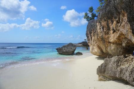 romantic caribbean beach under rock wall