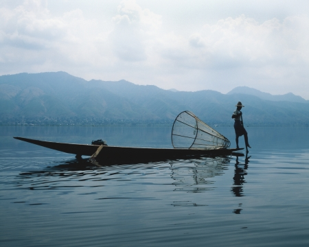 fisherman with boat on the Inle Lake, Shan State, Myanmar photo