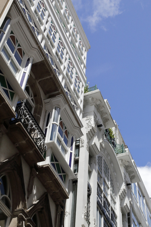 La Coruna, Spain - July 29, 2017: Typical Galician galerias, white enclosed balconies made of wood and glass, in the capital city La Coru? A