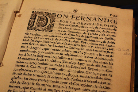 Borja, Spain - September 09, 2017: A close up view of an ancient book written in Spanish language with a big miniature at the beginning of the paragraph, printed on a thick yellowed paper