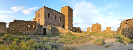 A landscape of the internal square of the abandoned Montearagon castle in the Aragon region, Spain, with a deep blue sky during a summer day