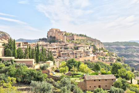A landscape, during a sunny summer, of Alquezar, a small medieval rural town with a castle monastery and a canyon in the Vero river, in Aragon, Spain