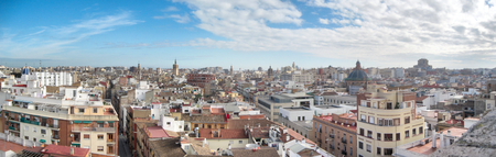A landscape of Valencia as seen from the Torres de Serrans (Serranos Gate) during a sunny winter day with blue sky and clouds, Spain