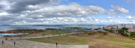 A landscape of a cloudy stormy sea and a grass lawn from Parque de Bens in Galicia capital city La Coru?a Zdjęcie Seryjne