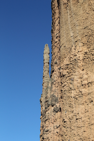 A karst rock formation on the high Mallos de Riglos mountains during a sunny day, in Aragon, Spain