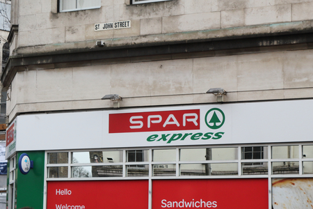 Cardiff, United Kingdom - December 01, 2018: The Spar Express supermarket sign in Saint Johns Street in Cardiff, United Kingdom