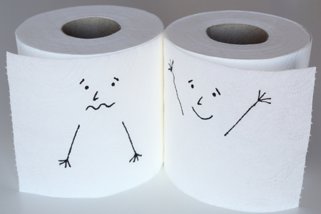 Two white toilet paper rolls sketched with a scared and a cheerful face close to each other, representing the fear and the happiness feelings