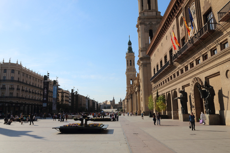 Zaragoza, Spain - April 13, 2017: A landscape of christian Pilar Cathedral and Plaza del Pilarwith people having a stroll during a sunny summer day in Zaragoza, Aragon region, Spain