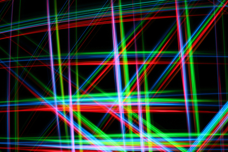 A colorful and glowing light painting abstract image with red, green, blue and yellow blurry lines over a black background, creating a net