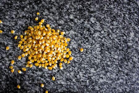 Unpopped popcorn. A type of corn that expands from the kernel and puffs up when heated.
