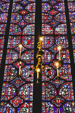 Chandelier and stained glass in a church of Paris in France