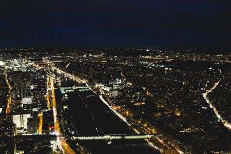 View of Paris from the top of the Eiffel Tower at night Фото со стока