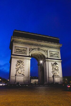 Arc of Triomphe in the night, Paris, France