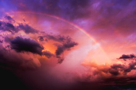 Rainbow in the clouds after a storm during sunset