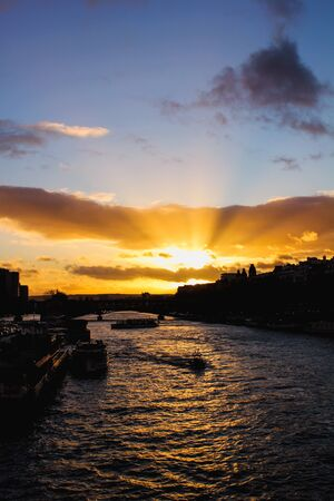 Sunset over the Seine river in Paris, France