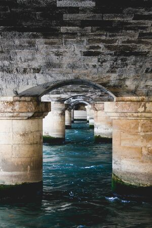 Under a bridge in the Seine river, Paris, France 写真素材