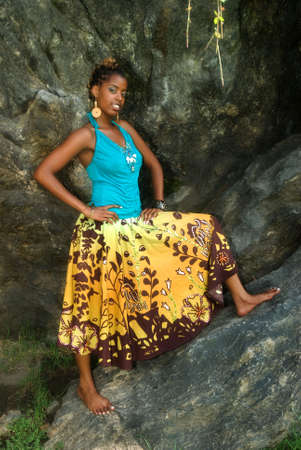 African American woman poses on a large rock Stock Photo - 5593607