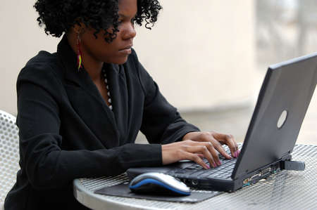 workforce: Young lady typing on the computer