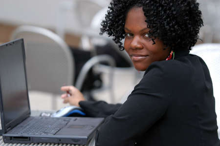 Woman looks as she is working on the computer. Stock Photo