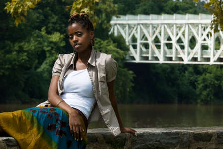 african american lady by water an bridge Stock Photo