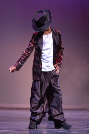 A boy dances on the stage