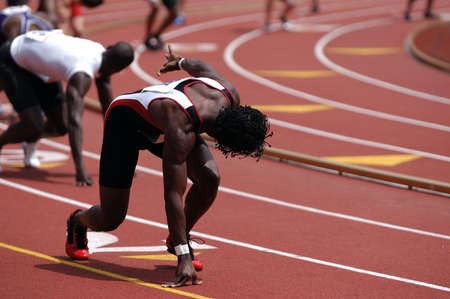Runner waiting to receive the baton on a 4 x 400 mm relay.