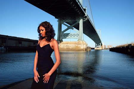 Beautiful model posing by Ben Franklin Bridge in Philadelphia
