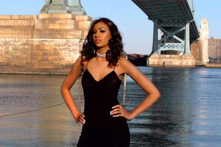 Beautiful model posing by ben franklin bridge in philadelphia Stock Photo