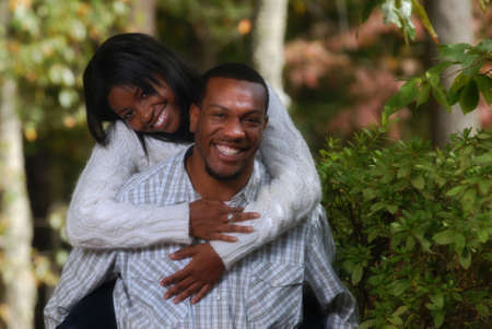 African-American playful couple outside bonding together photo
