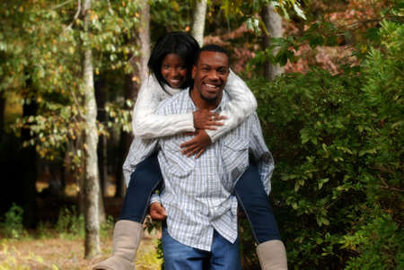 African-American couple enjoying the outside fall weather photo