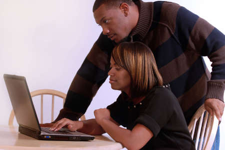 African-American couple searching on the computer together