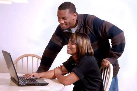 African-American couple enjoying the internet together