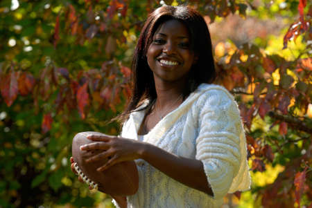 African-American woman with a football Stock Photo