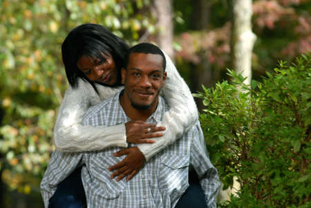 African-American couple together outside on a fall day bonding photo