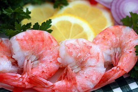 Large juicy boiled shrimp with lemon close up Stock Photo