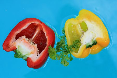 Floating fresh  peppers