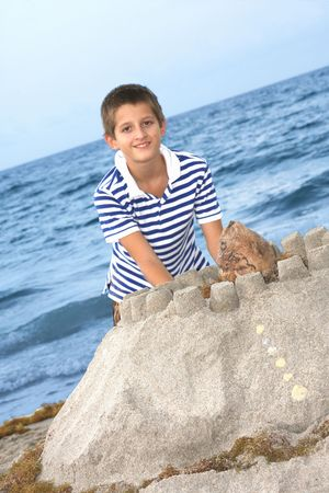 tenager: Sand castle on the beach