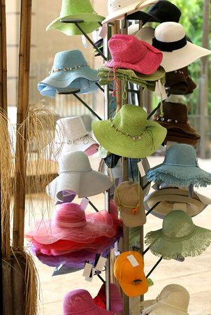 A rack of colorful straw hats