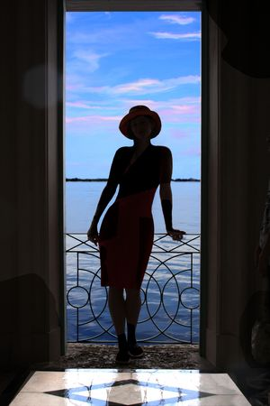 Beatiful woman silhouette at sunset, at the Vizcaya Tea   balcony