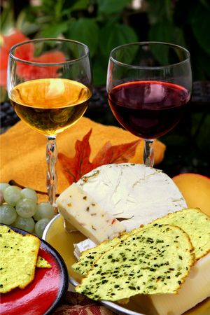 Different types of cheese and grapes and wine