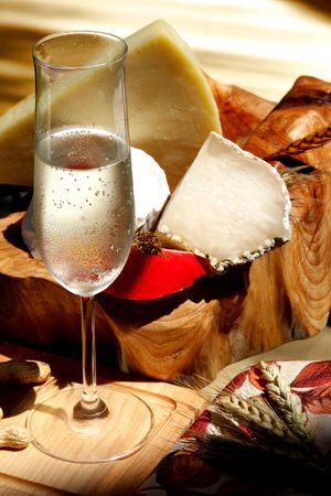 Glass of  sparkling  wine and assorted cheeses for wine tasting