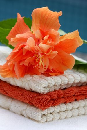 Stack of soft towels with hibiskus flower
