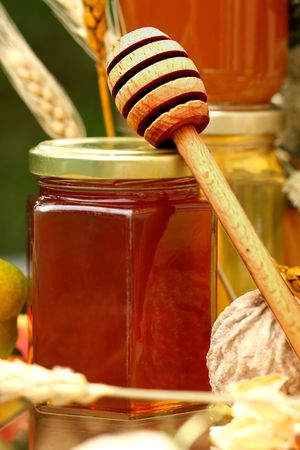 Jar of fresh honey with drizzle photo