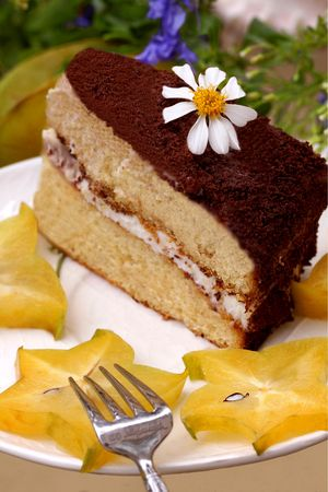 Piece of chocolat cake with starfruit  photo
