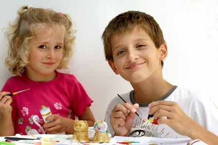 creativ: Brother and sister working on an art project together,over white Stock Photo