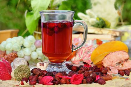 Cup of fresh herbal rosahips tea with fruits