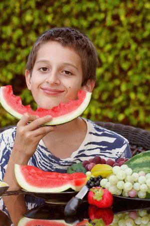 Boy enjoying watermelon Stock Photo - 3647071