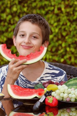 Boy enjoying watermelon Stock Photo - 3647071