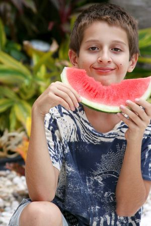 tenager: Boy enjoying watermelon